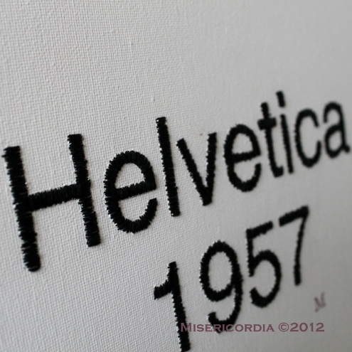 Helvetica hand embroidered canvas - Misericordia 2012